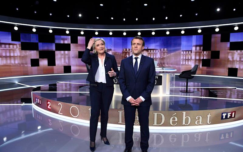 Marine Le Pen and Emmanuel Macron - Credit: Reuters