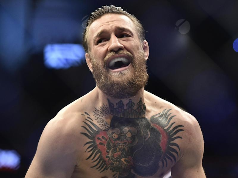 Conor McGregor celebrates his stunning victory: Getty