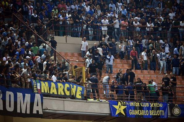 Inter Milan fans fight with Juventus supporters in the stands