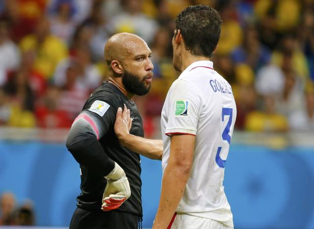 Goalkeeper Tim Howard of the U.S. (L) speaks with teammate Omar Gonzalez after making a save during their 2014 World Cup round of 16 game against Belgium at the Fonte Nova arena in Salvador July 1, 2014. REUTERS/Yves Herman (BRAZIL - Tags: SOCCER SPORT WORLD CUP)