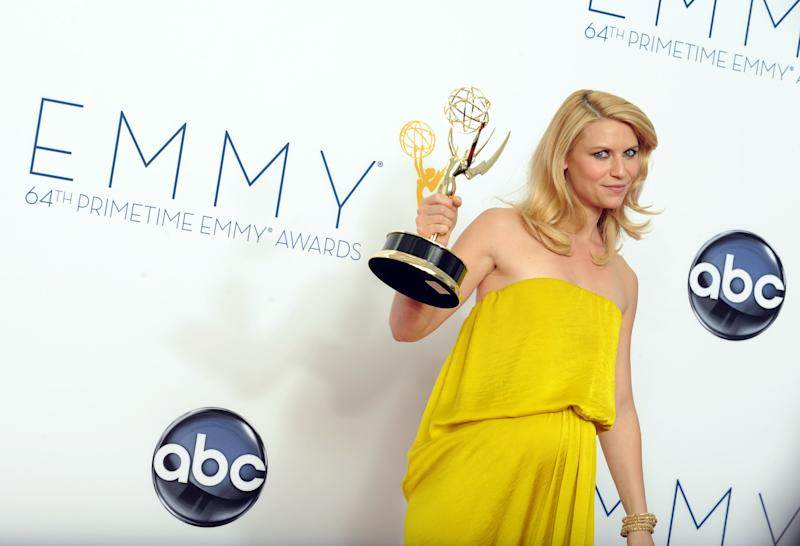"""Actress Claire Danes, winner of the Outstanding Lead Actress In A Drama Series award for """"Homeland,"""" poses backstage at the 64th Primetime Emmy Awards at the Nokia Theatre on Sunday, Sept. 23, 2012, in Los Angeles. (Photo by Jordan Strauss/Invision/AP)"""
