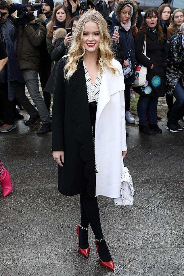 <p>Reese Wtherspoon's daughter continues to make her mark on the fashion world, as she arrives at the Valentino show in Paris, France on Sunday. (Photo: Pierre Suu/Getty Images) </p>