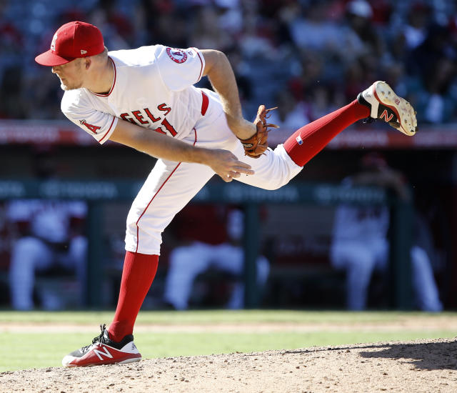 Los Angeles Angels relief pitcher Ty Buttrey delivers to a Seattle Mariners batter in the ninth inning of a baseball game in Anaheim, Calif., Sunday, Sept. 16, 2018. (AP Photo/Alex Gallardo)