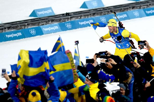 <p>Fredrik Lindstroem of Sweden heads along the finish straight on the way to winning the gold medal during the Men's 4×7.5km Biathlon Relay on day 14 of the PyeongChang 2018 Winter Olympic Games in South Korea, February 23, 2018.<br> (Photo by Matthias Hangst/Getty Images) </p>