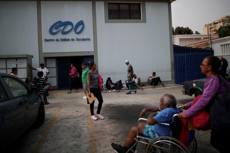 Patients with kidney disease wait with their relatives in front of a dialysis center for electricity to return during a blackout in Maracaibo, Venezuela. (Photo: Ueslei Marcelino/Reuters)