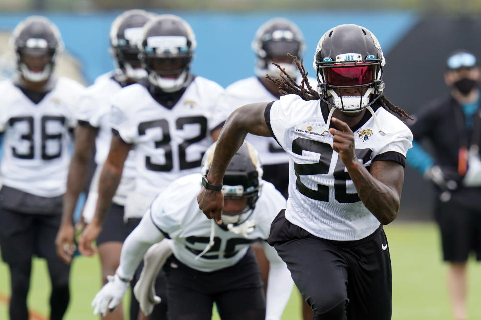 FILE - Jacksonville Jaguars cornerback Shaquill Griffin, front, runs sprints with teammates during an NFL football practice in Jacksonville, Fla., in this Monday, June 14, 2021, file photo The Griffin twins are already talking trash three months before they're on opposite sidelines for the first time in their lives. Shaquill and Shaquem Griffin were teammates at every level of football growing up in St. Petersburg. They also played together at UCF and with the Seattle Seahawks the last three years. The seemingly inseparable brothers hit free agency in March and hoped to be reunited again. But it didn't work out. (AP Photo/John Raoux, File)