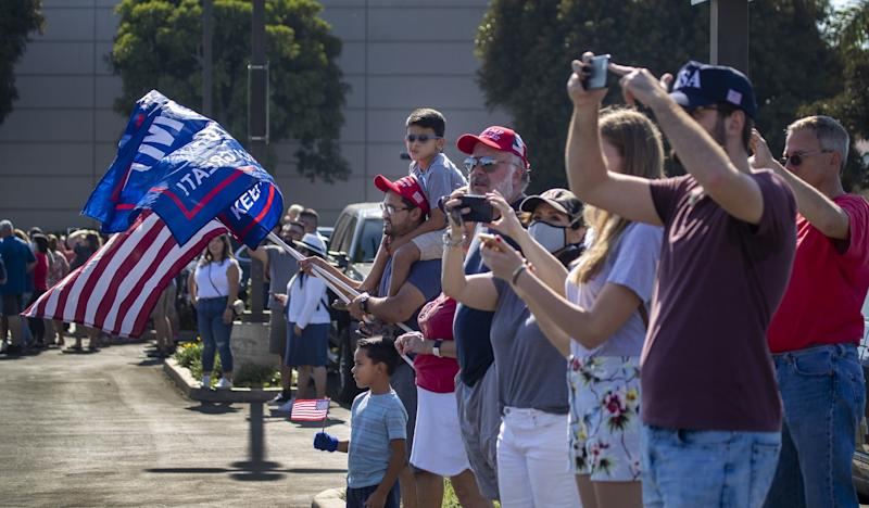 Supporters cheer on President Trump as he departs on Air Force One from Santa Ana.
