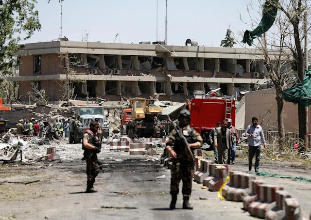 <p>Afghan officials inspect outside the German embassy after a blast in Kabul, Afghanistan, May 31, 2017. (Mohammad Ismail/Reuters) </p>