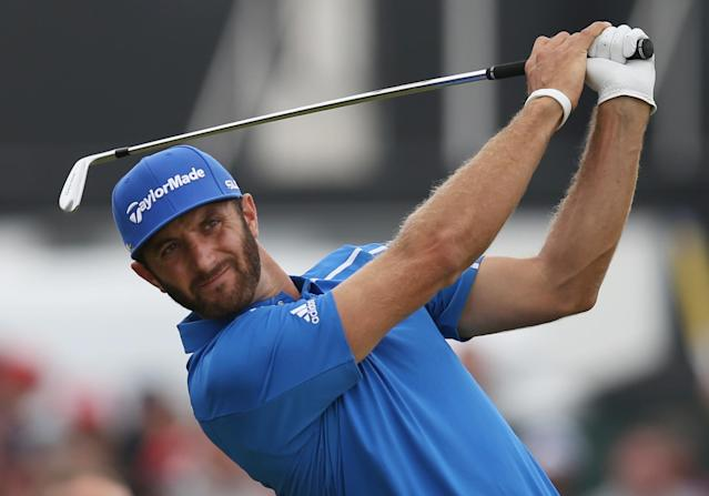 Dustin Johnson of the US plays his shot from the 4th tee during the final round of the British Open Golf championship at the Royal Liverpool golf club, Hoylake, England, Sunday July 20, 2014. (AP Photo/Scott Heppell)
