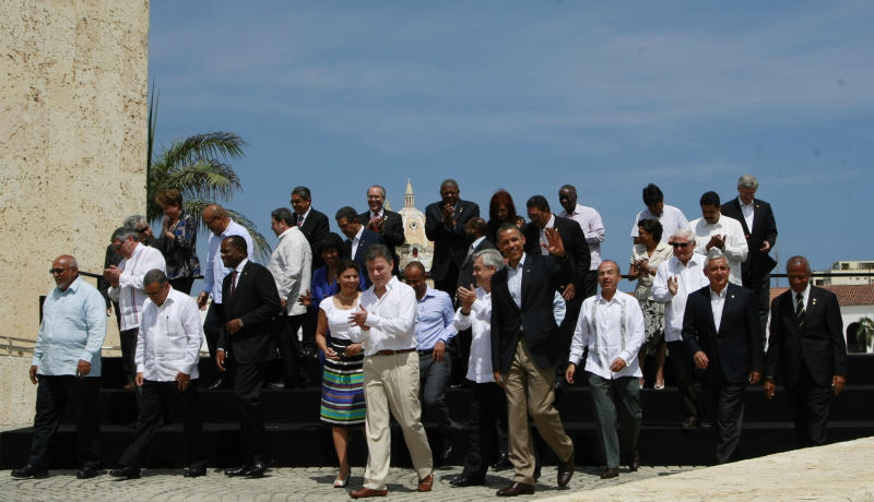 Leaders from Latin America, U.S., Canada and the Caribbean leave after the official photo at the sixth Summit of the Americas in Cartagena, Colombia, Sunday, April 15, 2012. (AP Photo/Fernando Llano)