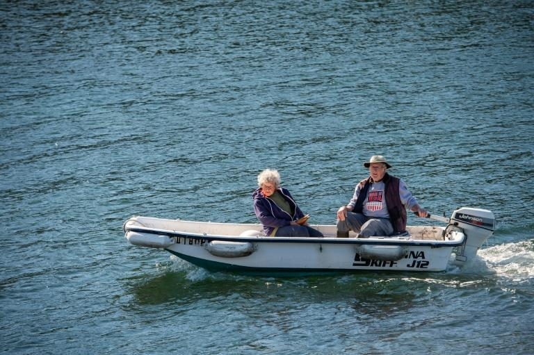 Oliver and her son head back to land after a morning of hauling in their lobster traps off the coast of Maine
