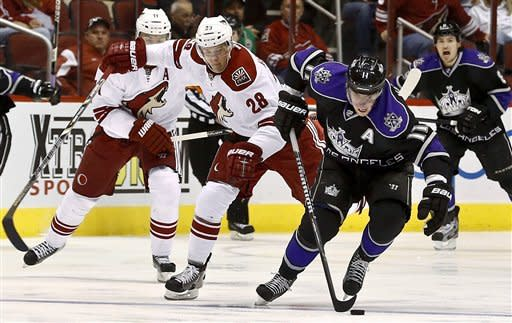 Los Angeles Kings' Anze Kopitar (11), of Slovenia, gets the puck in front of Phoenix Coyotes' Lauri Korpikoski (28), of Finland, during the first period of an NHL hockey game Tuesday, March 12, 2013, in Glendale, Ariz. (AP Photo/Ross D. Franklin)