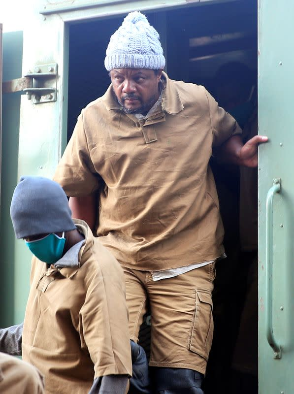 FILE PHOTO: Zimbabwean journalist Hopewell Chin'ono, who was arrested last month for supporting anti-government protests, arrives at court in Harare
