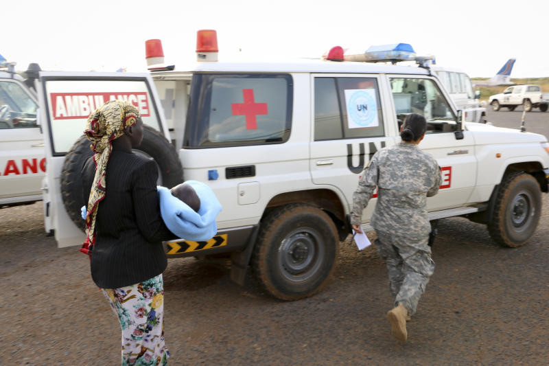 In this photo released by the United Nations Mission in South Sudan (UNMISS), wounded civilians from Bor, the capital of Jonglei state and said to be the scene of fierce clashes between government troops and rebels, are assisted after being transported by U.N. helicopter to Juba, South Sudan, Sunday, Dec. 22, 2013. South Sudan's central government lost control of the capital of a key oil-producing state on Sunday, the military said, as renegade forces loyal to a former deputy president seized more territory in fighting that has raised fears of full-blown civil war in the world's newest country. (AP Photo/UNMISS)