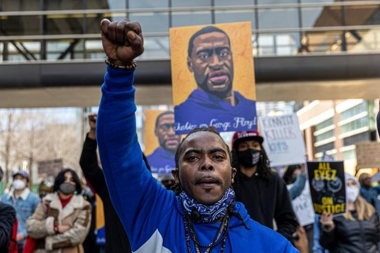 Demonstrators hold a picture of George Floyd during a protest outside Hennepin County Government Center where Derek Chauvin is on trial