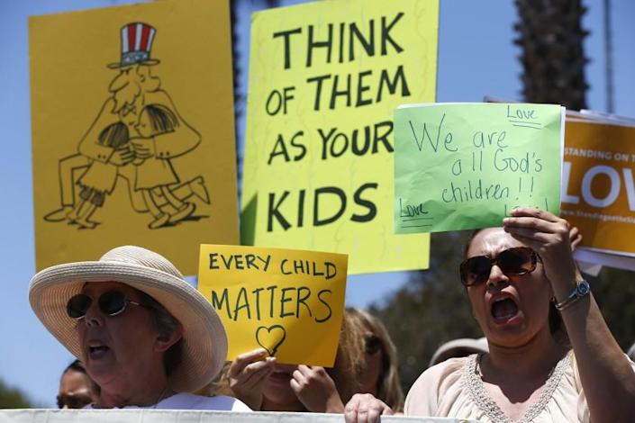 Karla Salazar, right, and Ellen Leonard on Tuesday joined nearly 100 demonstrators at the naval base in Port Hueneme, where hundreds of immigrant children are being housed.