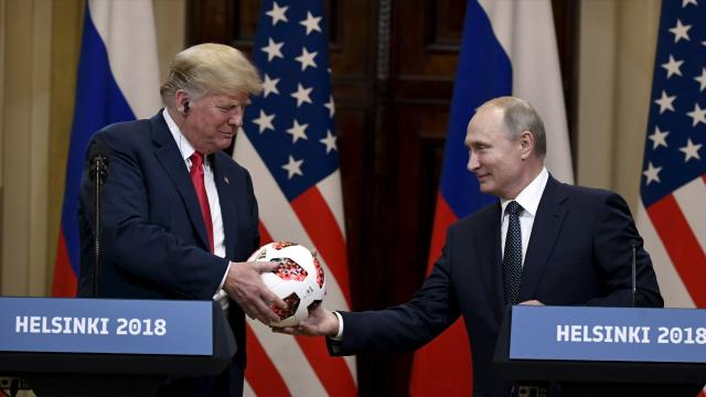 Russian President Vladimir Putin presents a soccer ball to President Trump during a joint press conference at the Presidential Palace in Helsinki on Monday. (Photo: Jussi Nukari/Lehtikuva via AP)