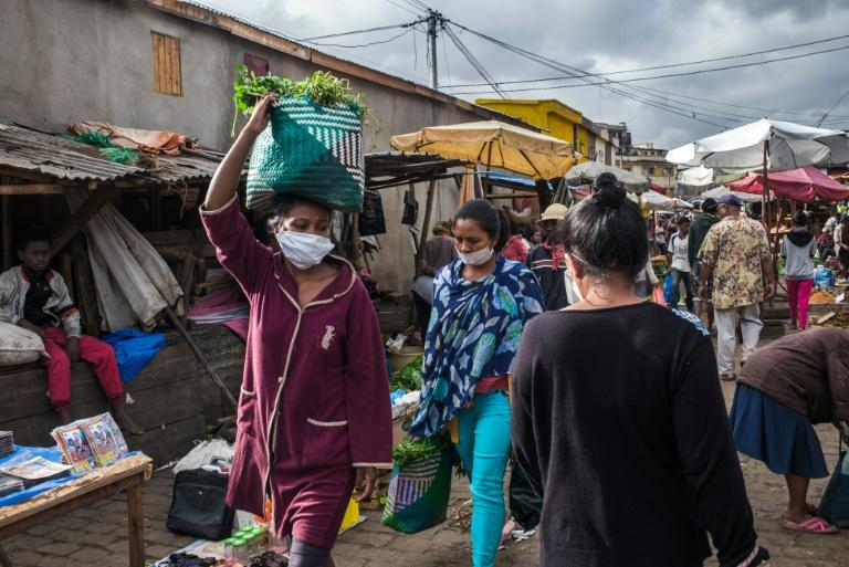 Facemasks, herbs and spices: Ambodivona has been even busier than usual since President Andry Rajoelina announced confinement measures, prompting the market to close every day at noon (AFP Photo/RIJASOLO)
