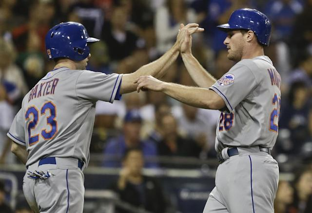 New York Mets' Mike Baxter, left, and Daniel Murphy high five after the pair scored on a double by Marlon Byrd in the eighth inning of a baseball game against the San Diego Padres Thursday, Aug. 15, 2013, in San Diego. (AP Photo/Lenny Ignelzi)