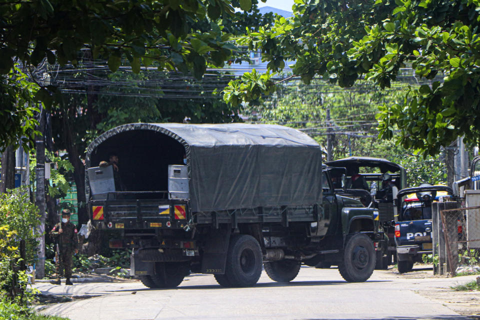 A police vehicle is parked at a road in South Okkalapa township to block anti-coup protesters' gathering in Yangon, Myanmar, Friday, April 9, 2021. An information blackout under Myanmar's military junta worsened Thursday as fiber broadband service, the last legal way for ordinary people to access the internet, became intermittently inaccessible on several networks. (AP Photo)