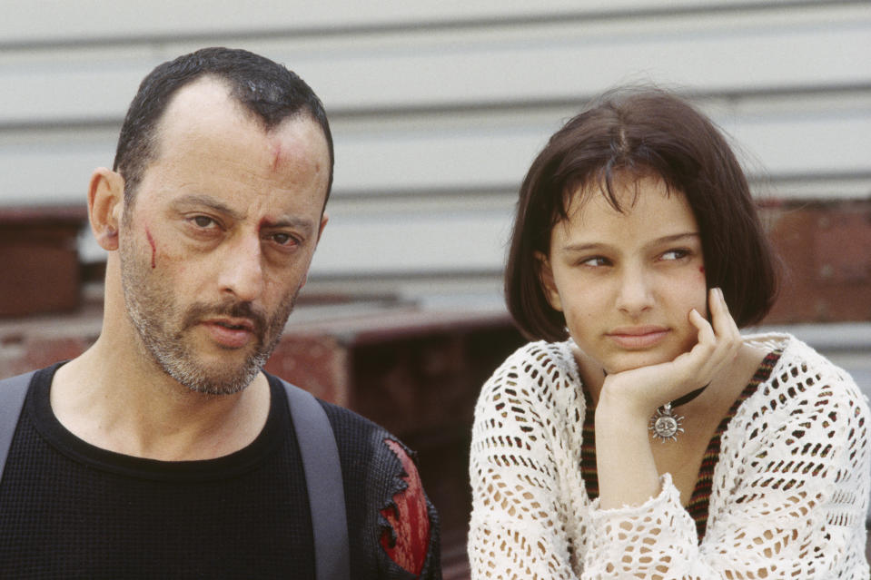 """American actress Natalie Portman and French actor Jean Reno on the set of the film """"Leon"""", directed by Luc Besson. (Photo by Patrick CAMBOULIVE/Sygma via Getty Images)"""