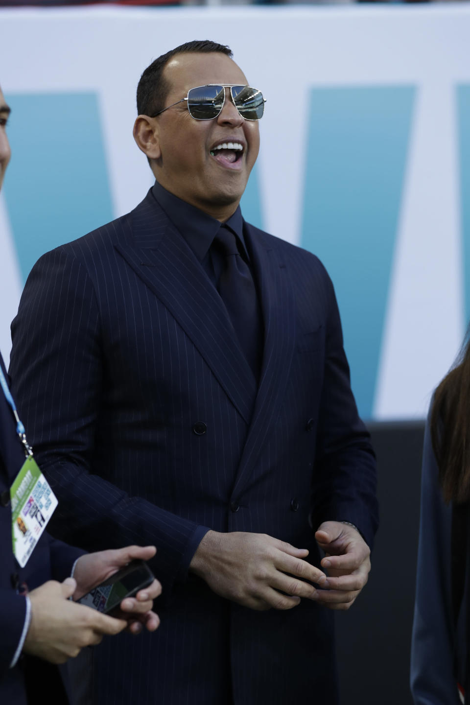 Former MLB player Alex Rodriguez watches teams warm up before the NFL Super Bowl 54 football game between the San Francisco 49ers and Kansas City Chiefs Sunday, Feb. 2, 2020, in Miami Gardens, Fla. (AP Photo/Wilfredo Lee)