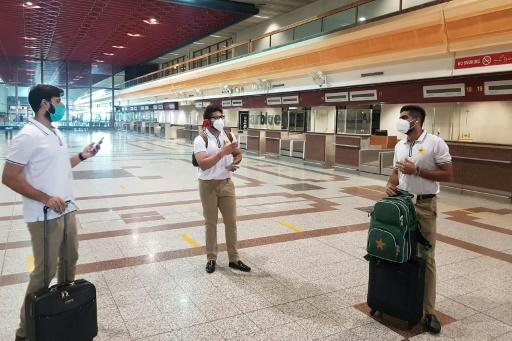 Pakistan cricketers Babar Azam (right), Imad Wasim (left) and Imam-ul-Haq (centre) arrive to check in at the Allama Iqbal International airport in Lahore before their departure for England