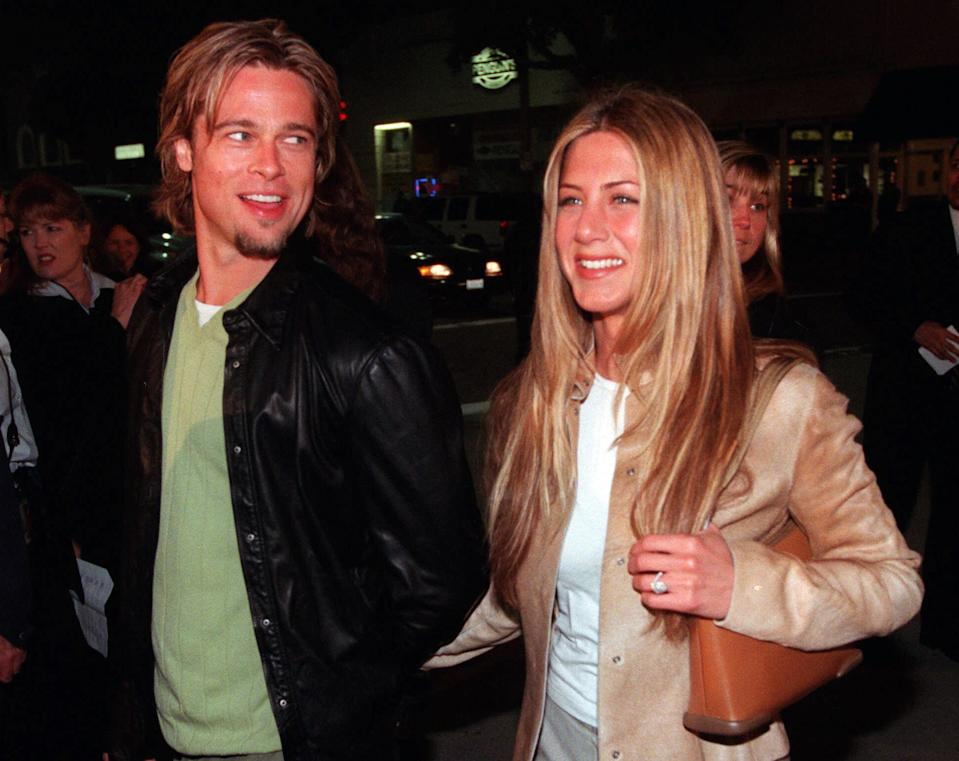 """FILE - In this March 14, 2000 file photo, actor Brad Pitt, left, and actress Jennifer Aniston, arrive at the premiere of the new film """"Erin Brockovich,"""" in the Westwood section of Los Angeles. Angelina Jolie Pitt has filed for divorce from Brad Pitt, bringing an end to one of the world's most star-studded, tabloid-generating romances. This is the second marriage for Pitt, who previously wed Jennifer Aniston. (AP Photo/Chris Pizzello, File)"""