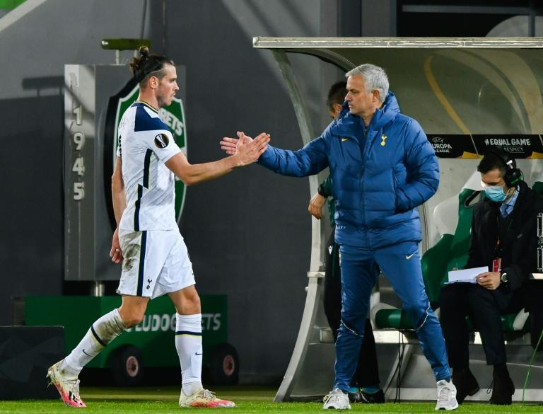 Jose Mourinho (right) wants Wales to limit Gareth Bale's involvement on his return to international duty