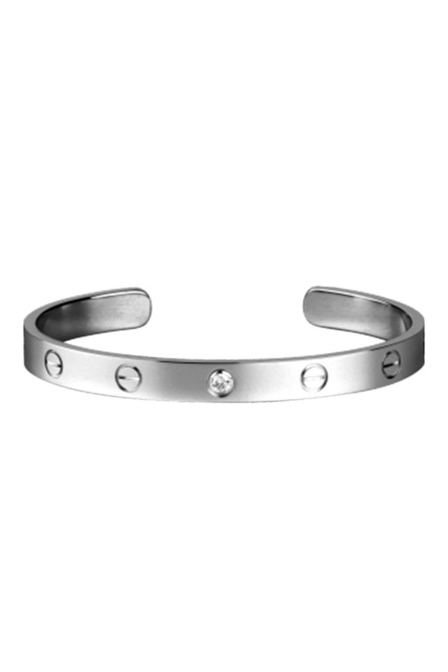 """<p>Cartier's love bracelet is a <a rel=""""nofollow"""" href=""""https://www.harpersbazaar.com/uk/fashion/jewellery-watches/news/g36812/10-classic-pieces-of-jewellery-every-woman-should-own/"""">timeless jewellery staple</a> – and the most searched-for piece of jewellery on Google. We love this one with a subtle diamond detail.</p><p><em>Diamond bracelet, £4,150, Cartier</em></p><p><a rel=""""nofollow"""" href=""""https://www.cartier.co.uk/en-gb/collections/jewelry/collections/love/bracelets/b6032517-love-bracelet.html"""">BUY NOW</a></p>"""
