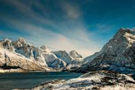 <p>Snow covered mountains surround a quiet lake in Norway // January 9, 2017</p>