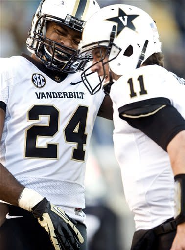 Vanderbilt wide receiver Wesley Tate (24) and quarterback Jordan Rodgers(11) celebrate after a scoring play against Wake Forest during their NCAA college football game on Saturday, Nov. 24, 2012, in Winston-Salem, N.C. (AP Photo/Winston-Salem Journal, Andrew Dye)
