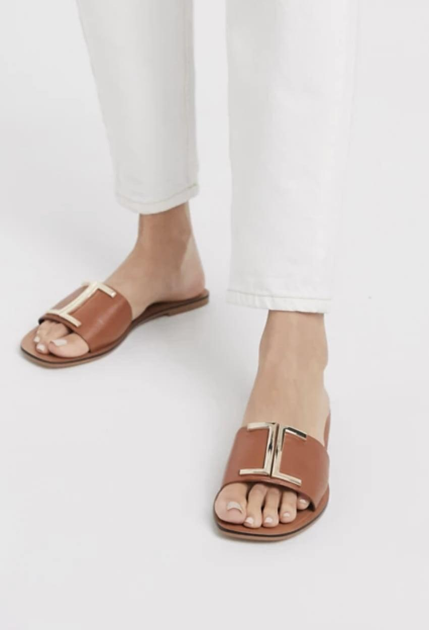 <p>These classic <span>ASOS Factor Leather Flat Sandals</span> ($26, originally $32) will go well with some pieces in your closet.</p>