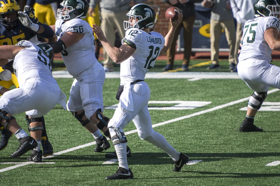 ANN ARBOR, MI - OCTOBER 31: Rocky Lombardi #12 of the Michigan State Spartans throws a pass during the first quarter against the Michigan Wolverines at Michigan Stadium on October 31, 2020 in Ann Arbor, Michigan. (Photo by Nic Antaya/Getty Images)