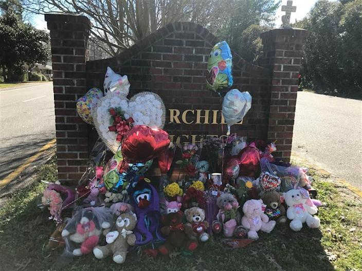 Flowers and balloons piled up at the entrance of Faye Swetlik's neighborhood, Feb. 14, 2020. Faye was a first-grader at Springdale Elementary School, a part of Lexington School District 2.