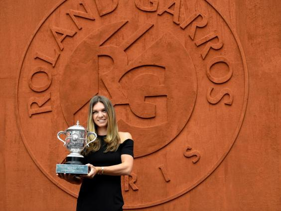 The Romanian finally got her hands on the The Suzanne Lenglen Cup last year (AFP/Getty Images)