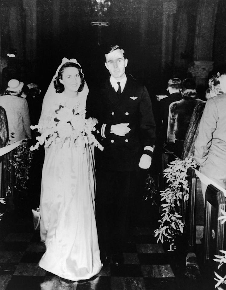<p>Navy Lieutenant George Bush and Barbara Pierce are married in the First Presbyterian Church in Rye, N.Y., on Jan. 6, 1945. (Photo: Corbis) </p>