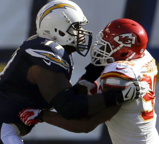 San Diego Chargers' King Dunlap, left, defends against the Kansas City Chiefs' Josh Martin during the first half of an NFL football game, Sunday, Dec. 29, 2013, in San Diego. (AP Photo/Lenny Ignelzi)