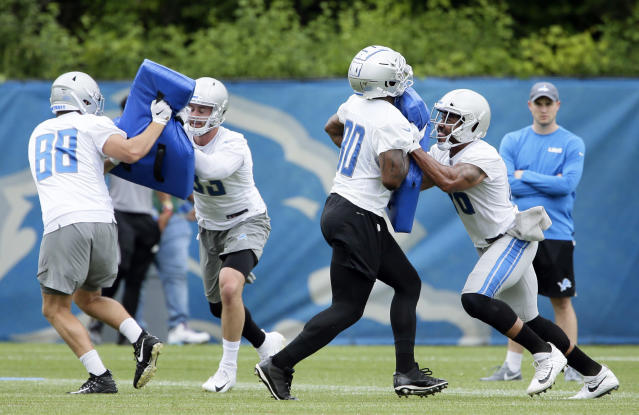 Detroit Lions tight ends T.J. Hockenson, from left, blocks against Jesse James while Michael Roberts (80) blocks against Jerome Cunningham during NFL football training camp Wednesday, June 5, 2019, in Allen Park, Mich. (AP Photo/Duane Burleson)