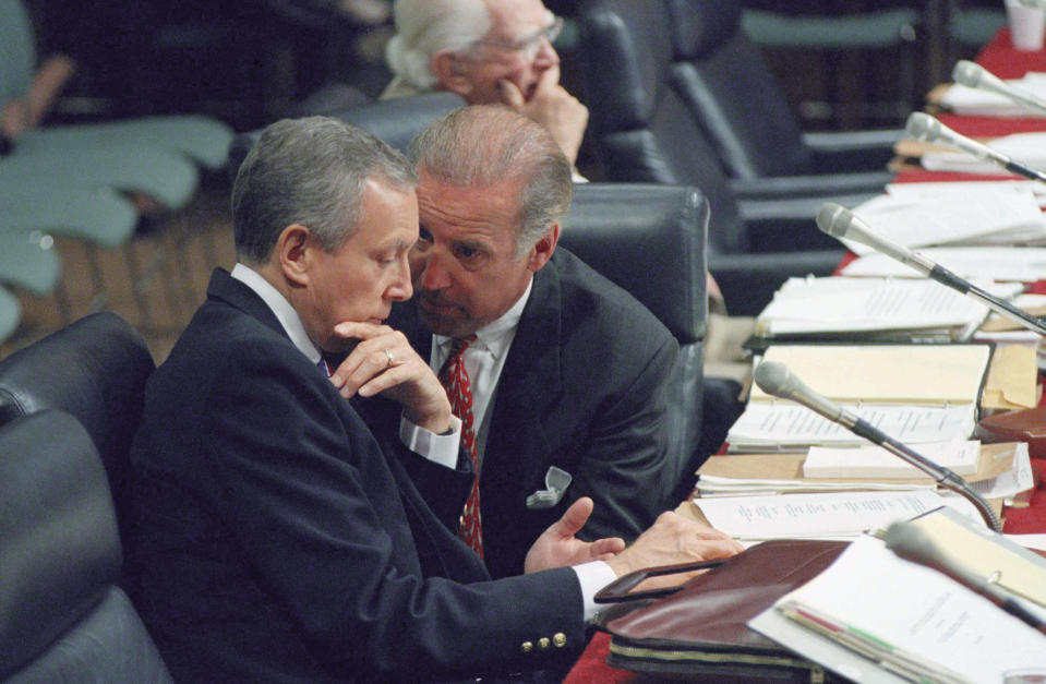 FILE - In this July 15, 1994, file photo Sen. Joseph Biden, D-Del., chairman of the Senate Judiciary Committee, right, huddles with Sen. Orrin Hatch, R-Utah, during a confirmation hearing for Supreme Court nominee Stephen Breyer, on Capitol Hill in Washington. (AP Photo/John Duricka, File)