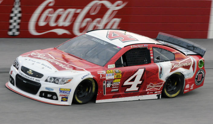 Kevin Harvick steers into Turn 1 during qualifying for a NASCAR Sprint Cup auto race at Darlington Speedway in Darlington, S.C., Friday, April 11, 2014. Harvick won the pole position for Saturday's race. (AP Photo/Mike McCarn)