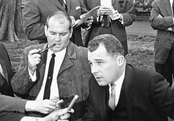 PHOTO: Boston attorney F. Lee Bailey, right, speaks to the press at a news conference while his client, Sam Sheppard, smokes a pipe in Cleveland, May 6, 1965. (AP)