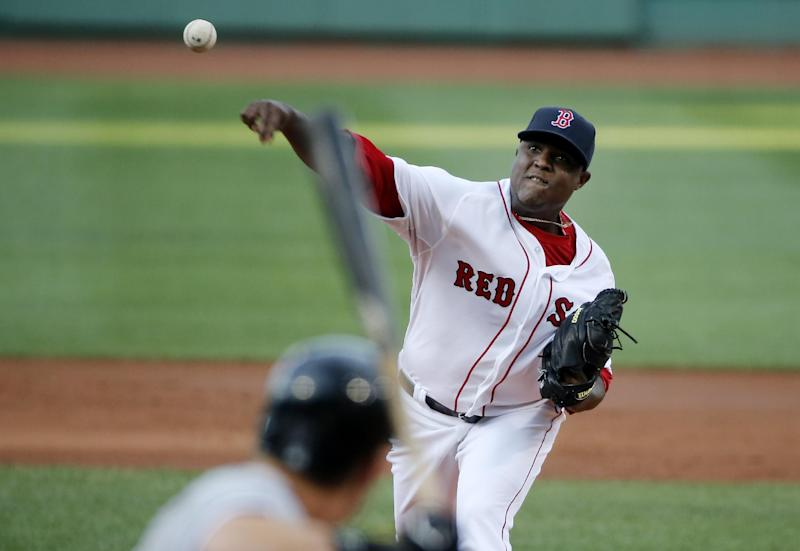 Boston Red Sox starting pitcher Rubby De La Rosa delivers to the Chicago White Sox in the first inning of a baseball game at Fenway Park in Boston, Wednesday, July 9, 2014. (AP Photo/Elise Amendola)