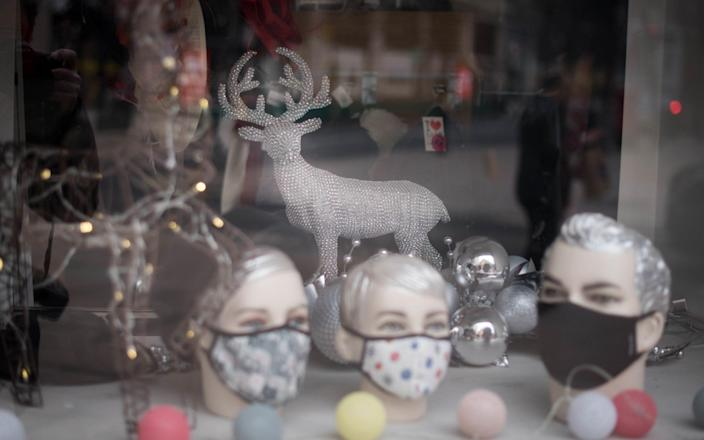 A shop on Oxford Street in London displaying Christmas decorations in March 2021