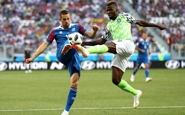 "5:18PM 60 mins - Iceland 0 Nigeria 1 Iceland corner. Sigurdsson jogs over to take it. The big men trot up from the back. It's a great ball in, and for a split second it looks like it might fall kindly for a blue shirt but Moses manages to hack clear. 5:16PM 58 mins - Iceland 0 Nigeria 1 A rocket of a shot from distance from Ndidi takes a nick off the defender and needs Halldorsson to take evasive action and tip over the bar. Attempt Saved: Nigeria 1 - 0 Iceland (Wilfred Ndidi, 57 min) 5:14PM 56 mins - Iceland 0 Nigeria 1 Iceland have already rescued a result after going behind once in this World Cup and they have responded really well here. Gylfi Sigurdsson tries to bundle his way into the box, and calls for a handball when it bounce up at Ebuehi, but the referee waves play on. 5:13PM 53 mins - Iceland 0 Nigeria 1 A problem for Iceland here: Ragnar Sigurdsson was caught by Musa's trailing leg as he dived in to block, and there is blood pouring from the back of his head. But after a lot of treatment, he gets strapped up and is okay to continue after a change of bloody shirt. 5:08PM GOOOOOOAAALLLL! Iceland 0 Nigeria 1 (Musa) The throw in is cleared with a monster header from Omeruo, and in the blink of an eye, Nigeria race up the other end with Moses on the right. He dinks in to the near post where Musa is there to control with one touch and rifle high into the net to put Nigeria ahead with only their second shot of the game. Unbelievable! Nigeria 1 - 0 Iceland (Ahmed Musa, 49 min) 5:07PM 48 mins - Nigeria 0 Iceland 0 Gislason drops deep to pick up the ball, and he lofts it into the box. Nigeria have a chance to clear but don't take it, and Omeruo can only boot out for a throw in. Gunnarsson lines it up... 5:05PM 46 mins - Nigeria 0 Iceland 0 Nigeria have their first shot just a few seconds into the second half. Etebo drilling low at goal, but Halldorsson saves pretty easily. 5:04PM Second half A change for Nigeria: Ebuehi replaces Idowu, who was booked at the end of the first half. No change in system. Iceland get the half started. 5:03PM Legends in attendance Former Arsenal forward Nwankwo Kanu is at the ground today. And that's Iceland's Birkir Kristinsson on the right. Kanue and Kristinsson chat Credit: getty images 4:48PM Half time It's goalless at the break but Iceland have had by far the best of that 45 minutes. Nigeria have had more of the ball and have probably been better than they were against Croatia, but they will need to improve massively if they are to win here. A big second half to come. Possession: Nigeria vs Iceland Nigeria vs Iceland shots on goal 4:47PM 45 mins +1 - Nigeria 0 Iceland 0 Another cross causes problems for Nigeria and the feintest of touches takes it away from Bodvarsson. Ragnar Sigurdsson heads wide from the corner. 4:46PM 45 mins - Nigeria 0 Iceland 0 Sigurdsson whips the free-kick in from the right, perfectly into the corridor of uncertainty (I love that phrase) . Finnbogason attacks it but almost goes with his hip (yeah, really), and just doesn't get anything like enough on it. Two minutes added on. 4:44PM 44 mins - Nigeria 0 Iceland 0 Idowu is the first player in the referee's notebook, after he fouls Saevarsson. 4:44PM 43 mins - Nigeria 0 Iceland 0 Iheanacho this time overhits a corner. It is easy to blame the fact that he is a centre-forward taking corners - as with Harry Kane at the Euros - but it does seem like someone else should be taking them. He hasn't put a good ball in yet. 4:42PM 41 mins - Nigeria 0 Iceland 0 Iceland look by a distance the more likely to score. Another long ball causes problems, with Bodvarsson nodding back to Gislason, who rides a challenge and drills low into the box, but it's just behind Finnbogason. 4:38PM 38 mins - Nigeria 0 Iceland 0 Moses gives chase under a long ball which he knows he is never going to reach. He gets the slightest of nudges from Magnusson and goes down, winning a free-kick in a very good position. Iheanacho doesn't beat the first man and Iceland clear. 4:36PM 36 mins - Nigeria 0 Iceland 0 Whipped ball into the Nigeria box from very deep on the right by Saevarsson causes all kinds of concern. Balogun gets the tiniest of glances on it to take it off the forehead of Bodvarsson who is arriving at the back post. 4:34PM 34 mins - Nigeria 0 Iceland 0 After a good start this game has quietened down an awful lot. It's very warm in Volgograd and seems like it is having an effect. Gislason volleys at goal from Bodvarsson's flick. It flies way over the bar. 4:31PM 31 mins - Nigeria 0 Iceland 0 Nigeria win a free kick on the edge of the centre circle and they decide to send the big men forward for this one. Etebo over-hits it, though, and it sails out for a goal-kick. 4:30PM 30 mins - Nigeria 0 Iceland 0 Nigeria vs Iceland Just the two touches in the opposition box for each team so far. Very little threat on either goal. 4:28PM 28 mins - Nigeria 0 Iceland 0 John Obi Mikel, so ineffective against Croatia, is playing in the deeper position we in England know him for. Pushing Etobo further forward hasn't really changed things, though. Nigeria are still distinctly lacking creativity. Nigeria vs Iceland shots on goal 4:25PM 25 mins - Nigeria 0 Iceland 0 Iceland do what Nigeria have so far opted against by launching a free kick on halfway into the box. But the Super Eagles stand firm and clear. Again. Another high ball into the box, another Nigeria clearance Credit: AFP 4:21PM 22 mins - Nigeria 0 Iceland 0 One quick turn from Sigurdsson on the edge of his own box and he turns defence into an Iceland attack. They go down the right and earn another throw-in in an advanced position, which is basically like a corner for them. The ball is push up but not quite away by Uzoho, and Gislason rockets a volley at goal. Moses blocks but he's in some pain. That's right in the gonads. Ouch. 4:19PM 19 mins - Nigeria 0 Iceland 0 Moses comes off the flank well to nip in and poke away from left-back Magnusson, and it looks like it might open up, only for Moses's final ball to let him down, wrongfooting Musa, and Iceland clear. 4:17PM 16 mins - Nigeria 0 Iceland 0 Best moment of the game for Nigeria as Iheanacho does well down the right, cuts back and delivers into the box. Ragnar Sigurdsson and Arnason combine to scramble it clear but Nigeria look buoyed. 4:14PM 14 mins - Nigeria 0 Iceland 0 And soon after Gunnarsson is called into action. He launches a monster throw into the box, but again Nigeria deal with it well. 4:13PM 12 mins - Nigeria 0 Iceland 0 Gunnarsson takes an elbow to the rib in a challenge with Iheanacho and he needs a minute's rest. A slight worry for Iceland that their throw-ins may be hindered, but he's okay to continue. 4:10PM 10 mins - Nigeria 0 Iceland 0 At the 10 minute mark, Iceland have had the better of this one. Nigeria vs Iceland shots on goal 4:07PM 7 mins - Nigeria 0 Iceland 0 Iheanacho is on Nigeria corners. Not a bad delivery but Iceland clear. 4:06PM 6 mins - Nigeria 0 Iceland 0 Another chance for Sigurdsson, as it opens up for him on the edge of the Nigeria box. He curls an effort at goal but it's really, really tame. Easily saved by Uzoho. That's a waste. Attempt Saved: Nigeria 0 - 0 Iceland (Gylfi Sigurdsson, 6 min) 4:05PM 5 mins - Nigeria 0 Iceland 0 Gislason takes on Balogun around the outside on the left wing, and goes down claiming a nudge. The ref isn't interested. 4:03PM 3 mins - Nigeria 0 Iceland 0 Sigurdsson (of the Gylfi variety), fires at goal. There's not a great deal of pace behind it and Uzoho should catch it, but he decides to parry over the bar. He does catch the resulting corner well, though. 4:02PM 2 mins - Nigeria 0 Iceland 0 Early throw in for Iceland and Gunnarsson jogs across to launch it into the box. It's cleared, and under a high ball on the edge of the box Arnason claims a push - and almost catches the ball! The ref agrees with him though, and it's an Iceland free kick 30 yards from goal. 4:00PM Kick off Nigeria get us under way. Game on. 3:59PM A message from the referee At the toss, it's possible to hear the Kiwi referee instruct both captains: ""Fair play, and watch the holding."" 3:58PM Anthem time A (very) significant portion of Iceland's 338,000 people are inside the stadium in Volgograd, and they are making a decent din. 3:52PM Permutations If Iceland win, they will be one point away from the second round and Nigeria will be out. Argentina will be very, very close to elimination. Draw and all three teams mentioned about will remain within one point of each other, with everything to play for in the final game. If Nigeria win they will jump above Iceland into second place in Group D. All three will still be in with a chance of qualifying for the second round. 3:48PM Huh? Iceland fans inside the stadium Credit: Getty images 3:35PM The kit we've all been waiting to see Nigeria will play in this jazzy number tonight, and everyone loves it. Credit: getty images Almost everyone, I should say. Here's Thom Gibbs ranking the World Cup kits. Let's just say he's not a fan. World Cup kits ranked 3:23PM DROPPED Arsenal man Alex Iwobi had a quiet game in Nigeria's opener against Croatia and hasn't made the starting lineup today. I'm sure we'll see something of him later, though. No Alex Iwobi today Credit: Getty images 3:11PM Some pre-match VAR fun test - do not delete 3:04PM Ch, ch, ch, chaaaanges Iceland Gone from 4-4-1-1 to two up front, with striker Bodvarsson coming in for centre-mid Hallfredsson Gislason also replaces Burnley's Joey Gudmundsson on the right side of midfield. Team in full (4-4-2): Halldorsson; Saevarsson, Arnason, R Sigurdsson, Magnusson; Gislason, G Sigurdsson, Gunnarsson, Bjarnason; Finnbogason, Bodvarsson Nigeria Omeruo comes in for Shehu at right-back, Ahmed Musa replaces Alex Iwobi, and Iheanacho in comes in for Ighalo up front. Team in full (3-5-2): Uzoho; Omeruo, Ekong, Balogun; Moses, Ndidi, Mikel, Etebo, Moses; Musa, Iheanacho 2:54PM The teams are in �� This is how we start the game against Nigeria.#fyririslandpic.twitter.com/pDAn99SxMF— Knattspyrnusambandið (@footballiceland) June 22, 2018 .@NGSuperEagles XI vs #Iceland#SoarSuperEagles#NGA#WorldCup#NGAISLpic.twitter.com/zFRfmXH5TL— ���� Super Eagles (@NGSuperEagles) June 22, 2018 2:46PM Pre-match predictions Have a go on our forecaster to see who will come out on top today after you've given extra weight to the factors you consider most important. World Cup 2018 Simulator Single Game I've gone for 1-0 to Iceland in the office World Cup predictions game. It's probably also worth me pointing out that I haven't got a single correct score right so far in the entire competition. So, put all your money on a Nigeria win*. [*Don't actually do this.] 2:31PM What an opportunity Group D was very early on dubbed the 2018 World Cup's 'Group of Death', but who could have predicted it would be Argentina whose hopes would be all-but killed off at this early stage? A 1-1 draw with Iceland last Saturday was followed by defeat to Croatia last night to leave the group looking mightily open at the halfway stage: And so, Iceland versus Nigeria now takes on a whole lot more significance than we would have expected. The Scandanvians, so impressive in beating England at Euro 2016 and taking a point off Argentina, can almost subject Lionel Messi and co. to elimination if they win today. Three points against Nigeria would leave them needing only a point against Croatia next week to progress. And these two teams' performances in their first game give every reason to believe that an Iceland win is the most likely result. I was really impressed by them against Argentina. Not only their endeavour, work rate, aggression and togetherness, but going forward they showed real quality and composure in the final third. Nigeria, on the other hand, are just so clearly lacking in creativity that I am struggling to see how they will break Iceland down. Against England in their World Cup warm-up friendly, they looked lost for most of the game, and they never really got going against Croatia, either. Victor Moses and Alex Iwobi play out wide, but both need a ball-playing midfielder to find them in space for them to work their magic at club level. They simply aren't creative enough on their own. Then there's the fact that John Obi Mikel is still their No 10. Something is not right."
