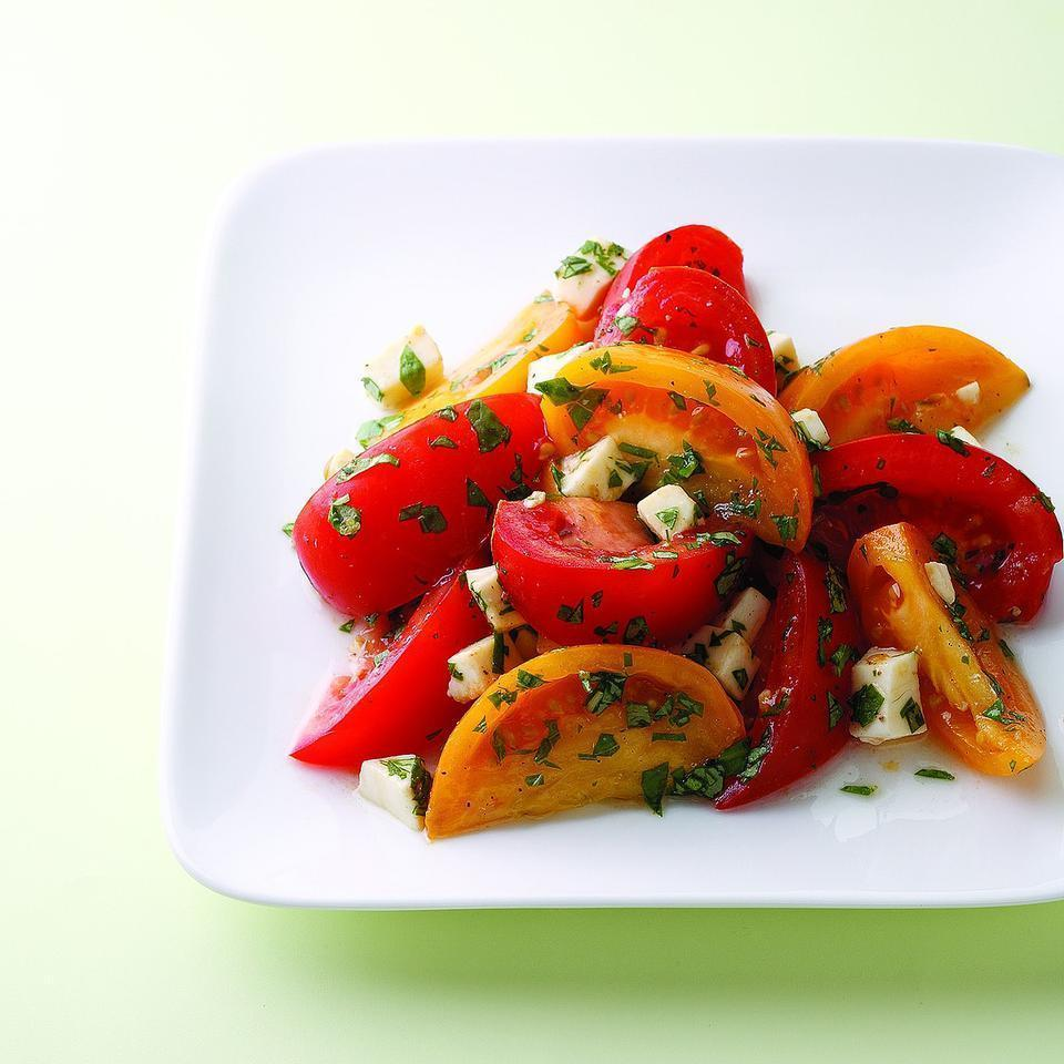 <p>Summer-ripe tomatoes and fresh mozzarella need only a sprinkling of fresh herbs, salt and pepper to shine in this simple summer salad.</p>