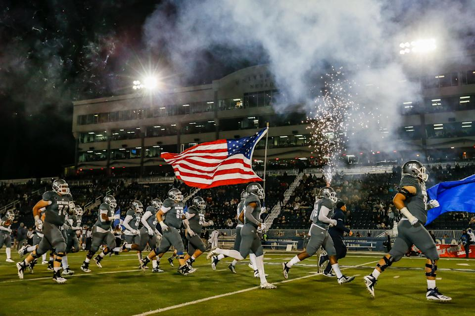 RENO, NV - NOVEMBER 10: Nevada Wolf Pack run onto the field for the game between the Nevada Wolf Pack and the Colorado State Rams at Mackay Stadium on November 10, 2018 in Reno, Nevada. (Photo by Jonathan Devich/Getty Images)