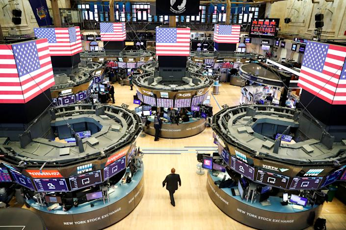 Traders work on the floor of the New York Stock Exchange shortly as coronavirus disease (COVID-19) cases in the city of New York rise, in New York, U.S., March 16, 2020. REUTERS/Lucas Jackson     TPX IMAGES OF THE DAY
