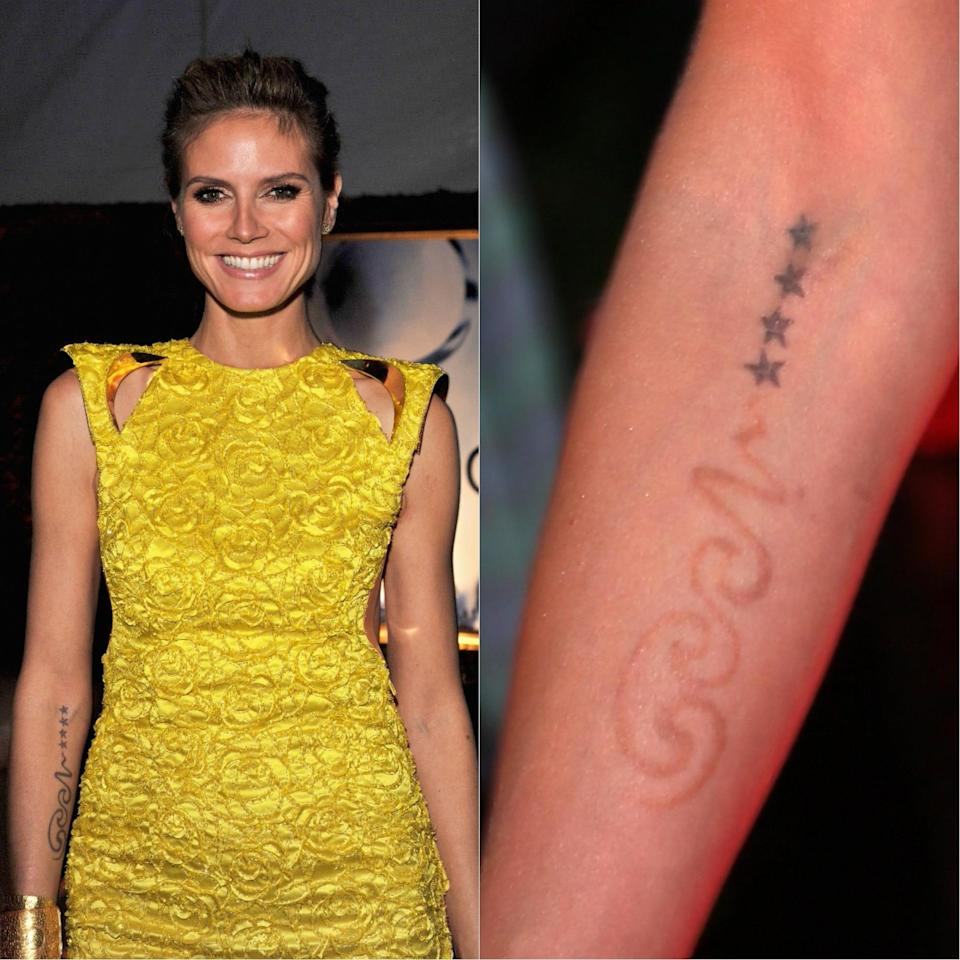 <p>Back in 2013, Heidi Klum had her tattoo of ex-husband Seal (partially) removed from her arm. <em>[Photo: Getty]</em> </p>