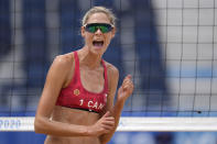Sarah Pavan, of Canada, reacts to a play during a women's beach volleyball match against Spain at the 2020 Summer Olympics, Monday, Aug. 2, 2021, in Tokyo, Japan. (AP Photo/Petros Giannakouris)